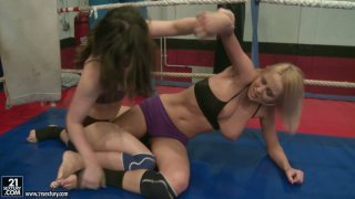 Spunked fighter Tiffany Doll goes against brunette and has a severe catfight image
