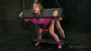 Chastity Lynn is fixed in pillory and banged in the mouth image