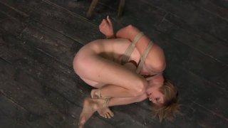 Flexible light haired chick Tracy gets bound_with ropes in the shed image
