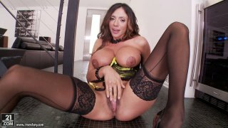 Extremely sexy and busty Ariella Ferrara rubs her honey cunt image