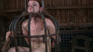 Ugly slut Hazel Hypnotic looks like a midevial witch in that cage image