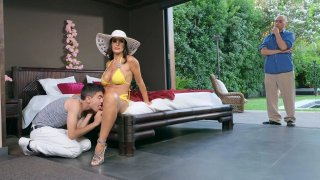 Stunning MILF Lisa Ann lays hand on pool-boy image