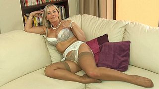 Blonde mature mom in sexy white lingerie image