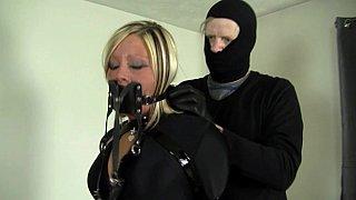 Slave in latex bondage image