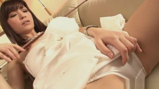 Horny Yuria Tominaga plays a violin and rubs her pussy image