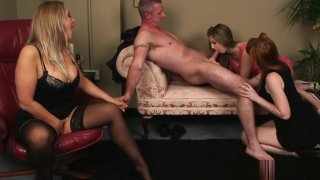 English ginger femdoms jerking sub in group image