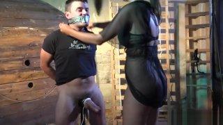 Tall domina flogging restrained slave image