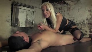 Smoking Mistress Torments Submissive With Ash image