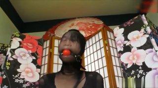 Image: Asian girl nylon encased ball gagged