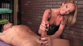 Unique femdome nuse glove handjob - Inked femdom masseuse tugging on roped cock image