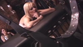 Behind the scenes footage during a hot_bdsm movie filming image