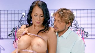 Reagan Foxx gets her big tits worshipped in the store image