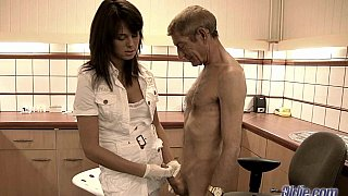 Young beautiful doctor treating old man image