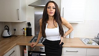 Busty Milf teasing in the kitchen image