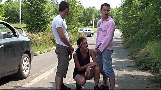 Brunette face-fucked on the side_of the road image