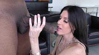 MILF sucking a young black cock image