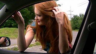 Redhead sucking dick in a_car image