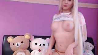 Lovely blonde camgirl masturbates by vibrator on webcam image