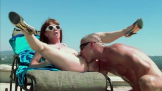 Horny redhead Rayveness rides beach guard and gets cumshot on her face image