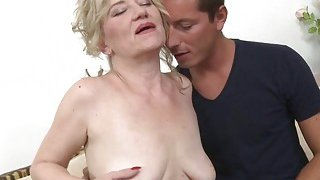 Blonde granny with saggy tits loves young cock image