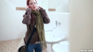 Image: Kinky slut Belinda sucks a cock in the public toilet for money