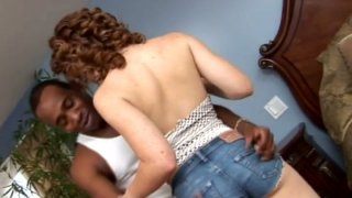 Redhead slut Charly Fire seduces black dude and sucks his dick image