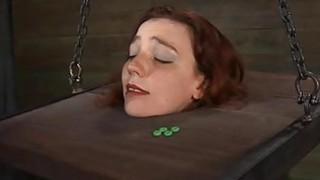 Masked girl with bare cunt receives wild flogging image