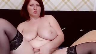 Mature busty milf Ella fingering on webcam image
