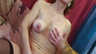 Slim 60yo granny in black stockings gets pussy filled with large cock image