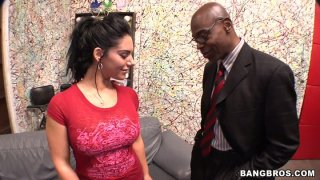 Provocative skank Bella Reese poses on a cam and gives an outrageous blowjob right in the office image