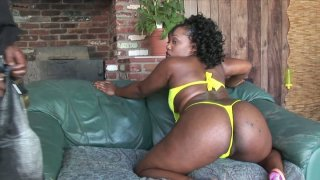 Ebony skinned slut Sinfully Thicc shows off her rounded shape and sucks a dick deepthroat image