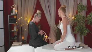 Redhead lesbian fucked on massage table image