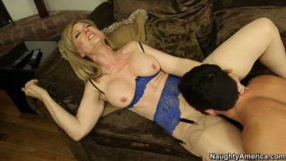 Kinky blond chick Nina Hartley is pro in sucking a cock image
