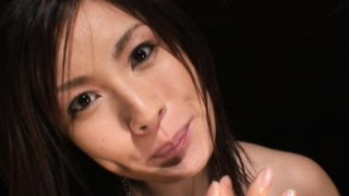 Hot Japanese MILF titty-fucks for a taste of cum image