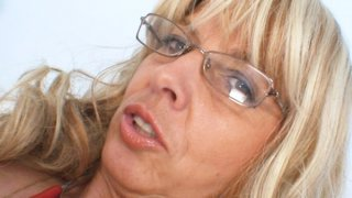 Old Milf wears glasses and toys herself with a stethoscope image