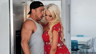 Image: Blonde mom Nicolette Shea is sucking cock in the kitchen