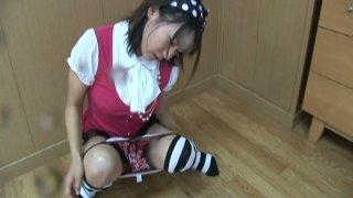 Pissing Japanese princess Maya Aikawa masturbates her muff image