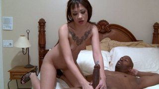 Pale brunette with too small tits Coco Velvet_gives a blowjob to a stiff black cock image