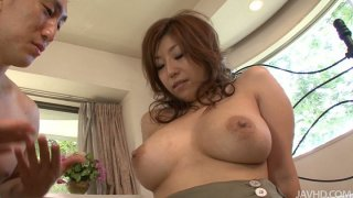Brownhead japanese slut Naho Hadsuki squeezes her big tits and gets her wet pussy licked dry image