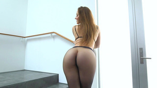 Dani Daniels posing in a sexy black pantyhose_and high heels image