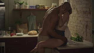 Image: Passionate sex in a dark kitchen