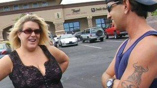 Mature BBW Jena sucks on a kinky dick in hot sex video image