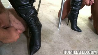 Humiliated Jackie Daniels licks cum off her girlfriend's boots image