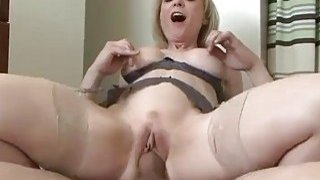Glamorous blonde mom can't wait to fuck her boy toy image