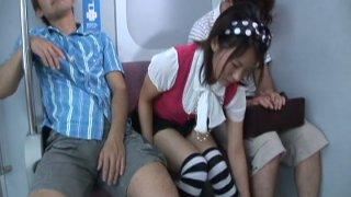 Sexy Asian student chick Maya Aikawa gets fingered in the subway image