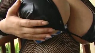 Stunning rich breasted Japanese woman Fuko squeezes her milky juggs image