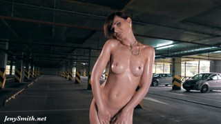 Jeny Smith exposing her perfect body in a parking garage image