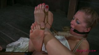 All tied up girlie Dia Zerva gets her wet pussy stimulated rough image
