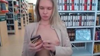 Young Blonde Show Tits In Library On Webcam image