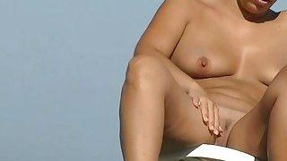 Sexy amateur hidden beach cam video on the nudist beach image